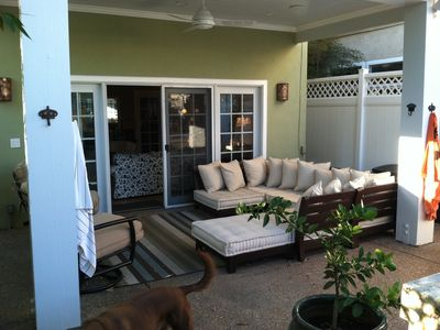 Covered patio with ceiling fan, Bose outdoor speakers, outdoor sectional sofa.