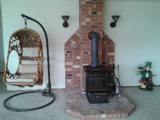 Camano Island house photo - Woodburning stove and swinging birdcage chairs in family room&Leprechaun visitor