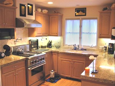 Enjoy the chef's kitchen with breakfast nook for six and counter stool