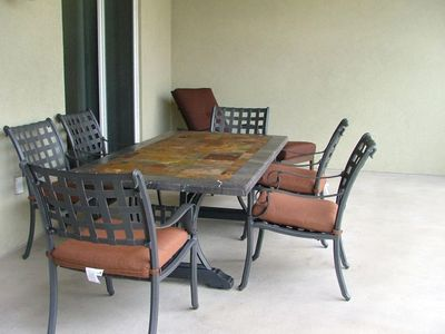 Eat and enjoy the gulf view at the new slate table or relax in the chaise lounge