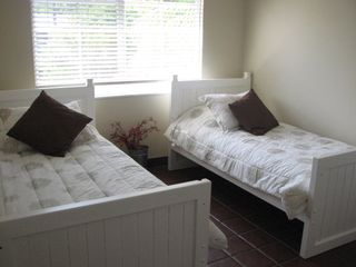 Tavernier house photo - Christmas Palm guestroom features 2 twin beds...