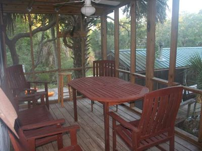 Relax on the screened porch overlooking the creek.