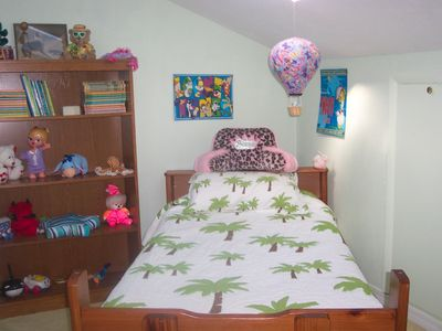 Child's room off master bedroom on 2nd floor, twin bed, book case & dresser