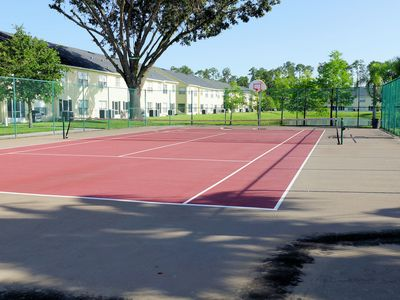 Community tennis and basketball court