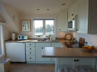 Provincetown condo photo - Kitchen with breakfast bar and dining stools