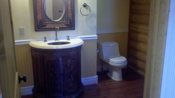 main level bathroom with claw foot jetted tup