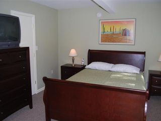 Rehoboth Beach house photo - Bedroom with new furnishings, queen bed, full bathroom and TV