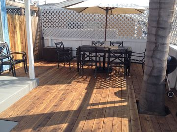 Oxnard bungalow rental - Dine al fresco on the large deck with the sand just steps away!