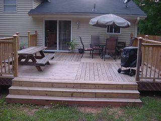 Duluth house photo - Large deck w/ BBQ and seating area.