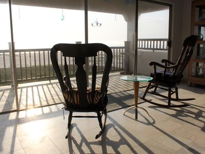 Rocking chairs overlooking the ocean.