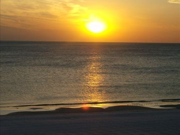 sit on the balcony and watch the sun setting into the gulf of mexico