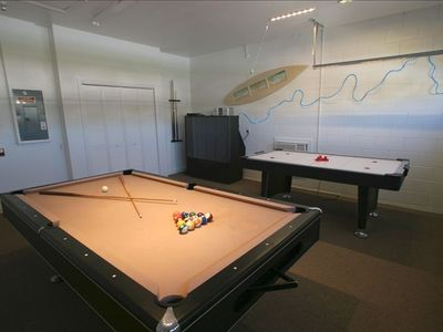 The game room with pool, air hockey, dart, arcade game, playstation 2.