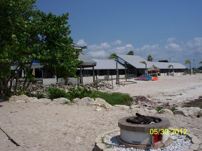 White sand beach w/watersports next to Sunset Grill and Tiki Bar! 1 minute walk!