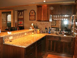 Black Mountain lodge photo - Pub style wet bar in game room with drink fridge