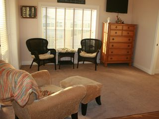 "Flagler Beach house photo - Part two of your king size suite. Sitting room with 30"" HDTV."