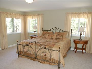 Master bedroom with king size bed and an attached sunroom with a twin bed & crib
