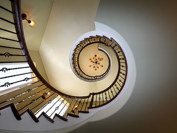Three story floating spiral staircase
