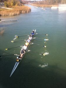 Rowing Team coming through the Narrows in front of the Boat Club