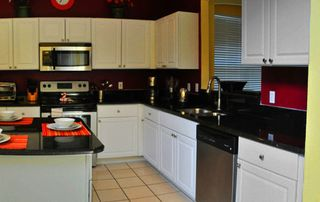 Emerald Island house photo - Fully equipped kitchen with stainless appliances