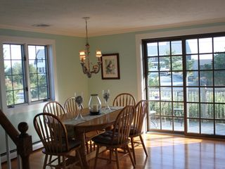 Sagamore Beach house photo - Dining room with sliders to patio, table fits up to 10 people.