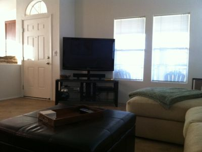 Living Room equipped with 50' flat screen tv, soundbar, subwoofer and DVD player
