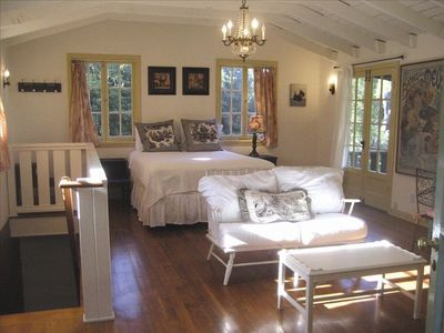 A roomy, upstairs master bedroom with balcony overlooks the grounds