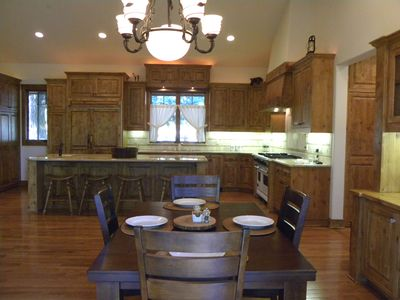 This picture of the Dining Area and Kitchen was taken from the large back porch.