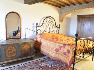 Casa BellaVista bedroom with ancient big iron bed