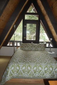 Queen size bed in the 2nd upstairs bedroom is perfect for guests