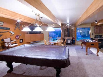 HUGE Game room has Big Screen TV, Poker, Full Size Pool, Foosbal and Wet Bar