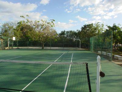 Tennis court and basketball court at background