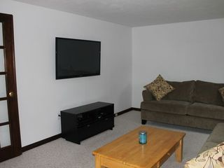 Bourne cottage photo - Living room with flat screen tv mounted on wall, cable, WIFI and Playstation.