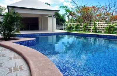 Large pool, outdoor showers and restrooms. Our condo overlooks the pool area.