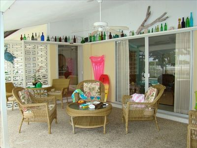 Comfortably Furnished Lanai w/ Conversation Area and Additional Table and Chairs