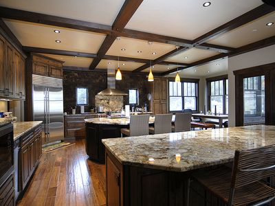 Kitchen photo with two large granite islands.
