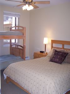 Second bedroom with Queen bed and extra set of bunks.