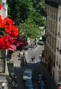 looking from the window to the red awnings of the rue Mouffetard market