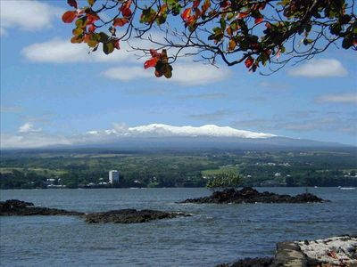 Rare view of Hilo Bay with snow atop MaunaKea.