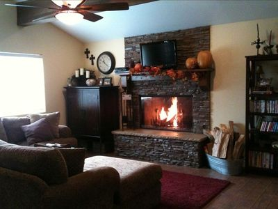 Family Room w/Free HBO, Cable TV, DVD Player & Wood Burning Fireplace.
