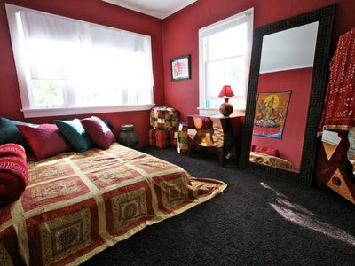 The red bedroom is very cozy