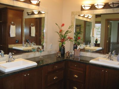 All bathrooms are large with double sinks, granite counters, & bath/ toilet area
