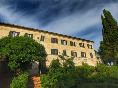 Farmhouse apartment surrounded by cypresses and olive trees, with panoramic view