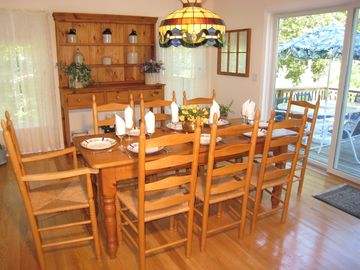Dining room with seating for eight guests.