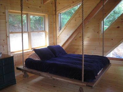 Hanging bed in loft.