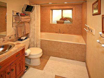 Spacious Bath with Heated Floor, Jetted Soaking Tub, TV