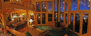 Pagosa Springs house photo - East Great Room with Quadrafire woodburning stove looking out to Lake Hatcher