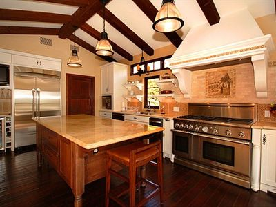 Kitchen features top of the line appliances and large marble island.