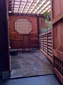 Gated entry to backyard that leads from Kitchen for outdoor dining