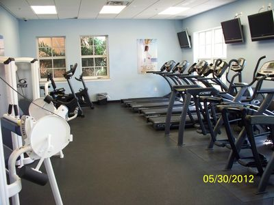 Fitness Center with Cardio and flat screens!
