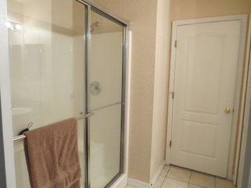 Main floor - Shared washroom with full shower.